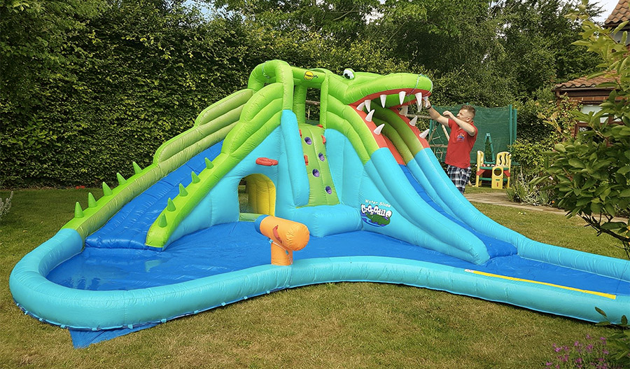 Inflatable pool with slides
